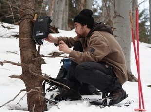 A Volunteer checking a trail camera